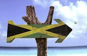 picture of reggae  - Jamaica wooden sign with a beach on background  - JPG