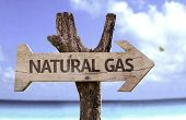 stock photo of nonrenewable  - Natural Gas wooden sign with a beach on background  - JPG