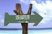 foto of masjid nabawi  - Saudi Arabia wooden sign with a river on background  - JPG