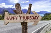 stock photo of thursday  - Happy Thursday wooden sign with a street background  - JPG