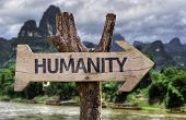 foto of pity  - Humanity wooden sign with a forest background - JPG