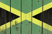 picture of rastafari  - Jamaica flag on wooden background - JPG