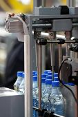 picture of bottle water  - Bottles in the machine in water factory - JPG