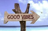 foto of universal sign  - Good Vibes wooden sign with a beach on background  - JPG
