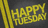 stock photo of tuesday  - Happy Tuesday written on the road - JPG