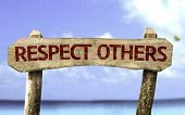 picture of respect  - Respect Others wooden sign with a beach on background - JPG
