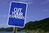 foto of waste reduction  - Cut Your Expenses sign with a beach on background - JPG