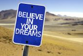 picture of persistence  - Believe in Your Dreams sign with a desert background - JPG