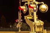 stock photo of railroad-sign  - Railroad crossing by night with sign in kingman - JPG