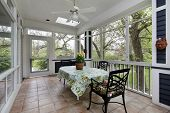 pic of screen-porch  - Porch in suburban home with tile floor - JPG