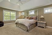 picture of master bedroom  - Master bedroom in luxury home with gold walls - JPG