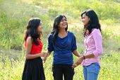 image of three sisters  - Simple portrait of three sisters in outdoor