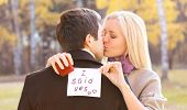 stock photo of propose  - Love relationships engagement and wedding concept - man proposing ring woman outdoors
