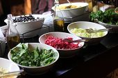 stock photo of buffet  - Plates with herbs and vegetables at the buffet