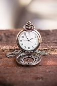 picture of differential  - pocket watch laying on a wooden surface - JPG
