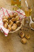 foto of love bite  - Cheesy bites with seeds wine in wicker basket nice gift - JPG