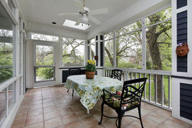 stock photo of screen-porch  - Porch in suburban home with tile floor - JPG