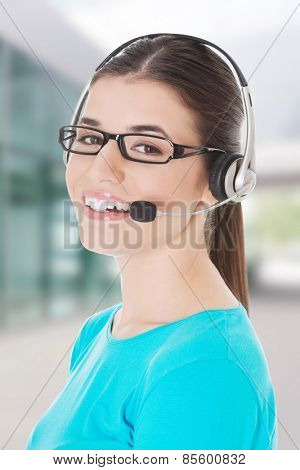 Young beautiful woman with headphones and microphone