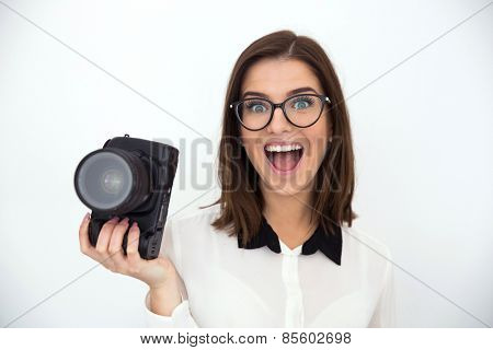 Surprised young businesswoman holding camera