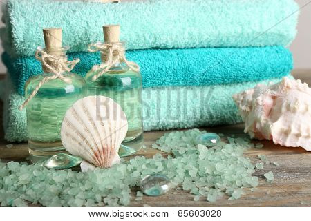 Spa composition with towels and sea salt on on wooden table