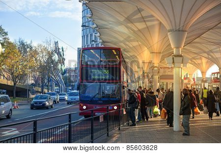 LONDON, UK - NOVEMBER 29, 2014: Stratford international, the central bus stop with commuters, who wa