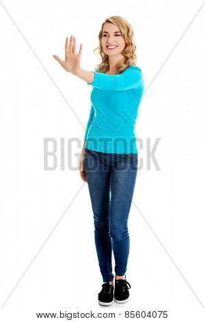 Front view woman pulling imaginary screen.