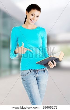 Young woman student with book