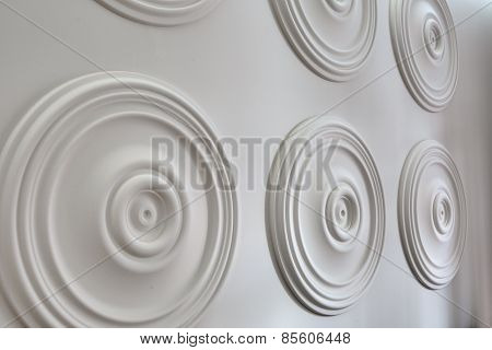 Round white stucco on the wall