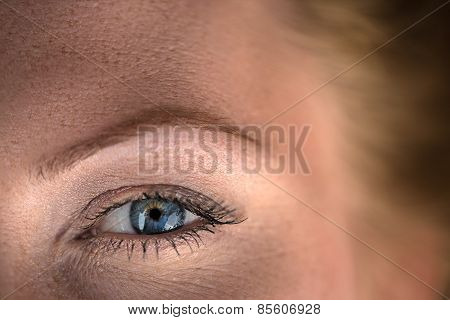 very close up eyes beautiful red-haired girl