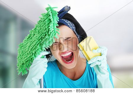Tired frustrated and exhausted cleaning woman screaming