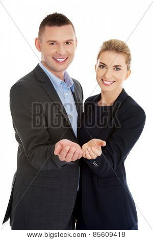Businesspeople reaching their hands to customers