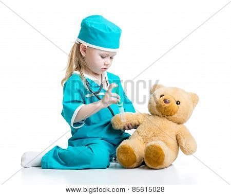 child girl with clothes of doctor playing toy