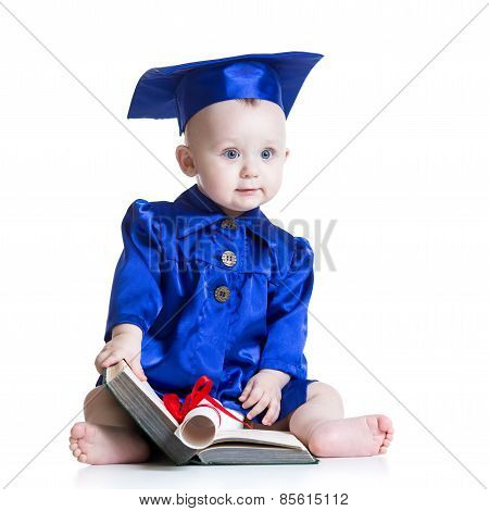 Portrait of cute baby in student hat with book