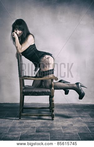 Woman Leaning On Chair