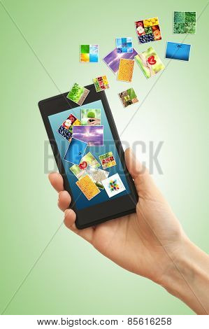 Touch screen mobile phone with streaming images on green background