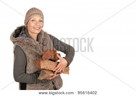 Beautiful young woman carrying firewood