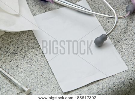 Stethoscope And Blank Paper
