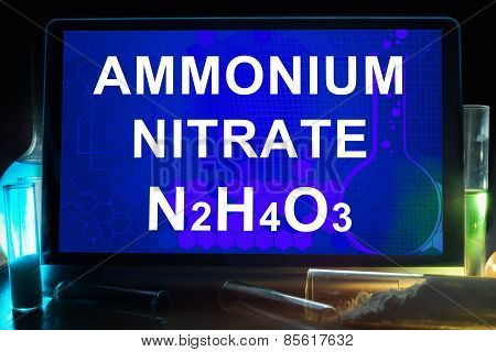 Tablet with chemical formula of  ammonium nitrate.