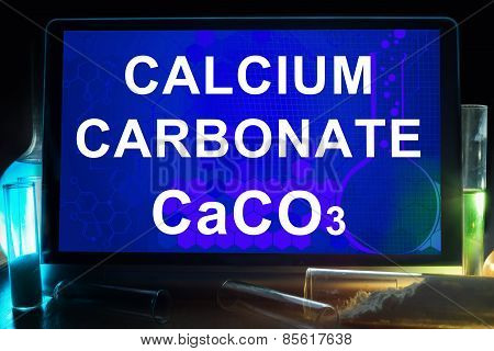 Tablet with chemical formula of  calcium carbonate.