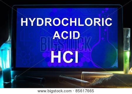 Tablet with chemical formula of  hydrochloric acid.