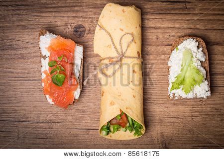 Tortilla Wrap With Vegetables And Two Sandwiches