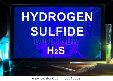 Tablet with chemical formula of  hydrogen sulfide.