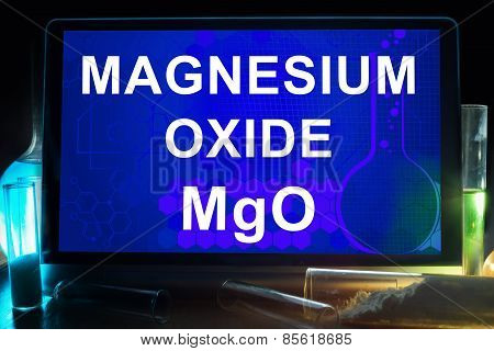 Tablet with chemical formula of magnesium oxide.
