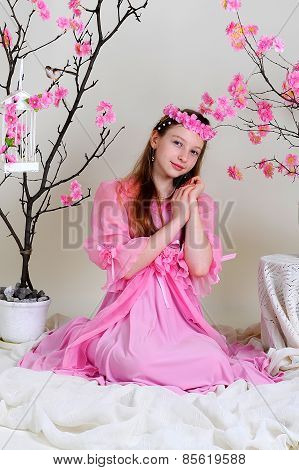 Girl In A Pink Dress And Wreath