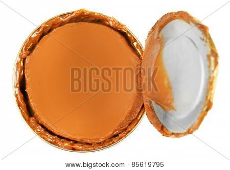 Can of boiled condensed milk isolated on white