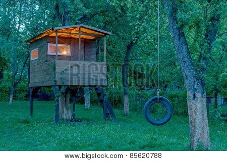 house on tree in evening garden