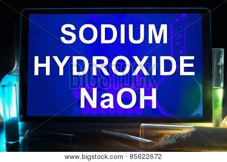 Tablet with chemical formula of sodium hydroxide.