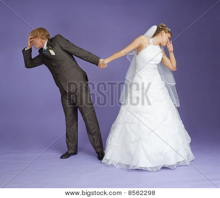 Comical Emotional Groom And Bride Holding Hands