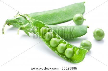 Fresh peas are contained within a pod isolated on a white background.