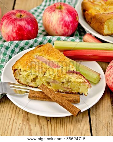 Pie with apple and rhubarb in plate on board